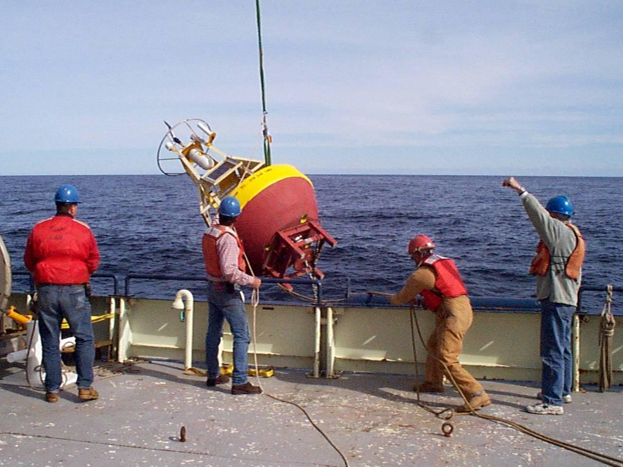 Jim Dunn, Jeff Lord, Horace Medeiros, and Jeff Stolp deploying the Southern Flank buoy on OC331 in October 1998.