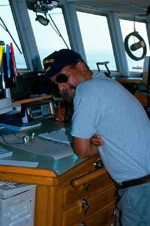 Chief Mate Diego Mello on Bridge; Dive Boat in Distance