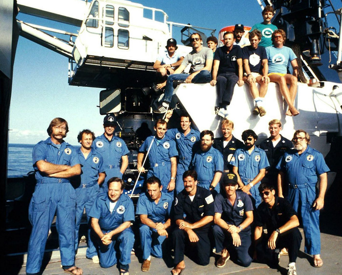 William Lange (2nd row, fifth from left) was part of the research team that returned to Titanic in 1986 with the submersible Alvin, on which pilots are sitting in the background