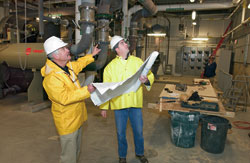 Bill McKeon (left), WHOI?s director of shore operations, reviewed blueprints with a construction project manager.