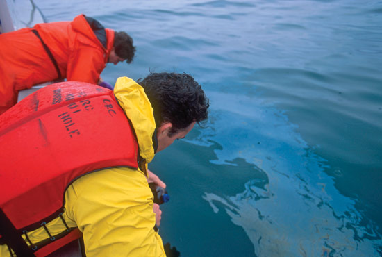 Bob Nelson and Chris Reddy collect water samples and oil ?pancakes? from Buzzards Bay