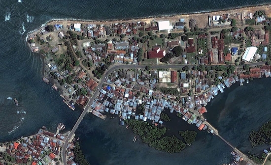 Satellite images reveal the shore of Banda Aceh, Indonesia, on June 23, 2004.