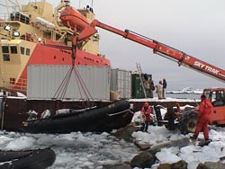 Several inflatable boats were used during the seafloor survey and needed to be taken out of the water almost daily to avoid ice damage. The <em>Laurence Gould</em> is in the background.