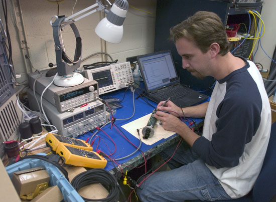 WHOI Engineer Keenan Ball tests a high-speed acoustic modem