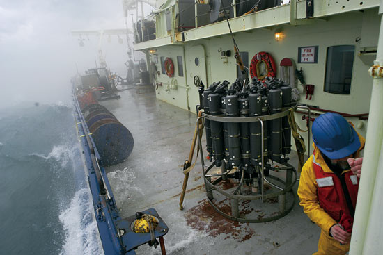 WHOI engineer Craig Marquette secures the door to the wet lab after recovery of a CTD (on deck)