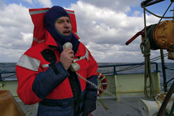 Chief Scientist Glen Gawarkiewicz relays information from the bridge to the fantail