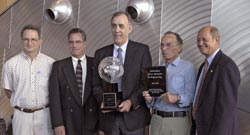 From left, WHOI engineers Jim Newman, Martin Bowen, Chris von Alt, Earl Young, and Emile Bergeron receive the Great Moments in Engineering award for building the prototype tethered undersea robot, Jason Jr.