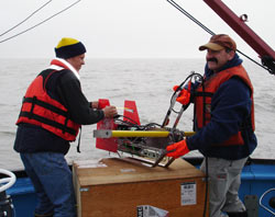 Steve Okkenen from the University of Alaska, Fairbanks, and Phil Alatalo from Woods Hole Oceanographic Institution deploy the Acrobat.