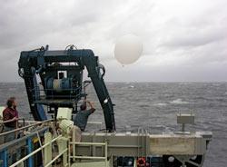 Atmospheric scientist Jim Edson launches a radiosonde