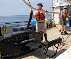 Dennis McGillicuddy helps prepare to lower the Video Plankton Recorder (VPR)