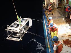 Researchers deploy a sampling sled to detect chemical tracers that helped them track how an eddy mixes water layers of the ocean.