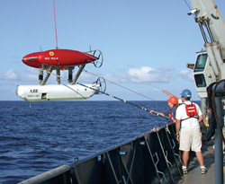 Crew members recover ABE aboard R/V Atlantis after a dive to detect hydrothermal vents on the Galapagos Rift in 2002.