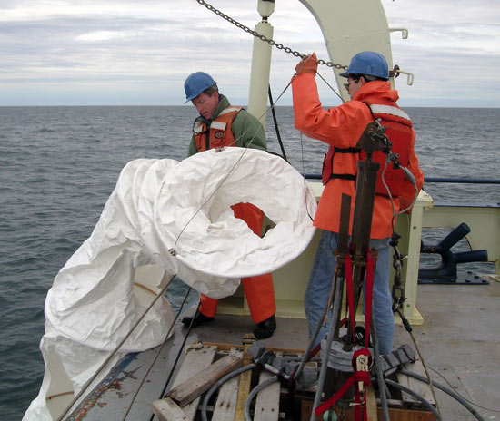deploying drifter in Bay of Fundy
