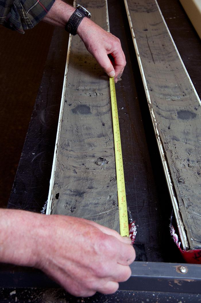 split sediment core being measured