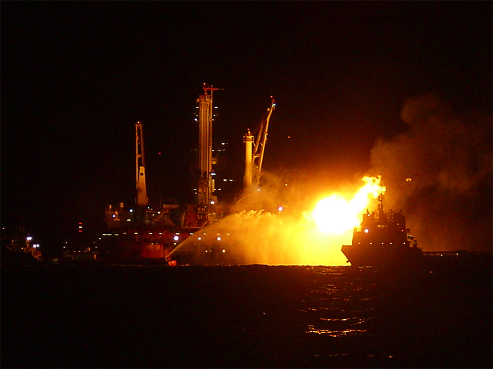 burning oil at night near Deepwater Horizon rig