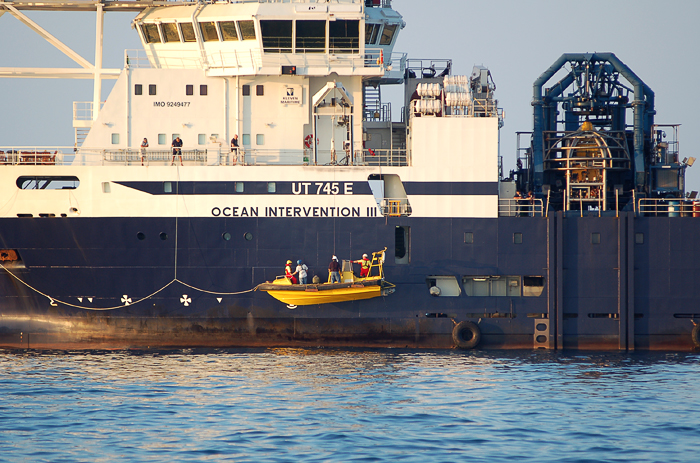 fast boat with passengers being hoisted onto the Ocean Intervention III