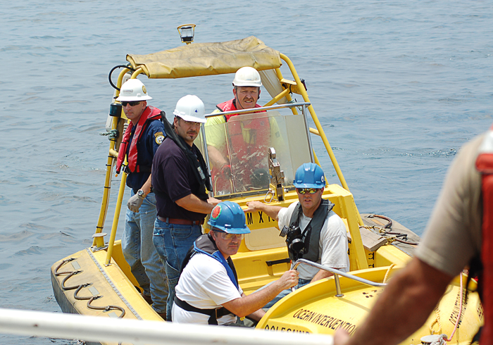Reddy, Camilli, and Sylva returning to Endeavor after overnight mission to sample material from wellhead