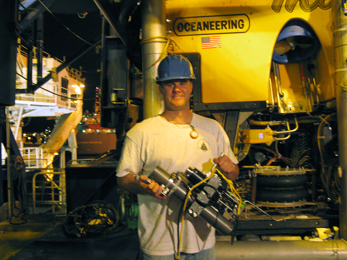 Sean Sylva with Seewald sampler prior to getting sample from wellhead