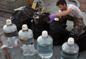 Jamie Becker preparing incubation bottles at sea in 2010
