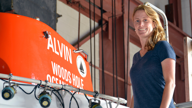 Loral O'Hara next to the research sub Alvin