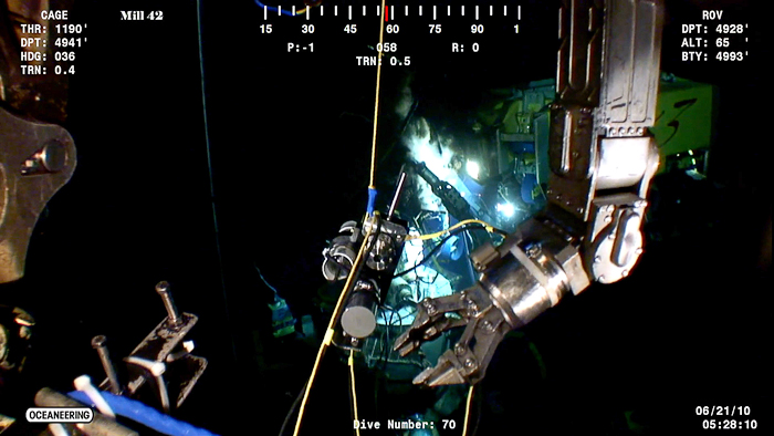 screen grab showing ROV arm and IGT sampler at Deepwater Horizon wellhead