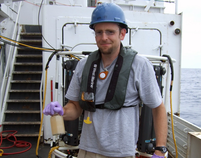 Ben Van Mooy with a water sample from Gulf of Mexico after oil spill