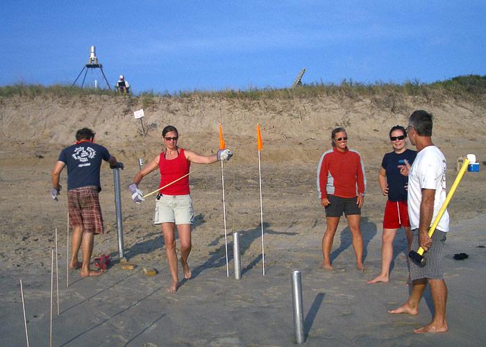 Rebecca Gast checks spacing of core sites on beach at Duck, N.C.