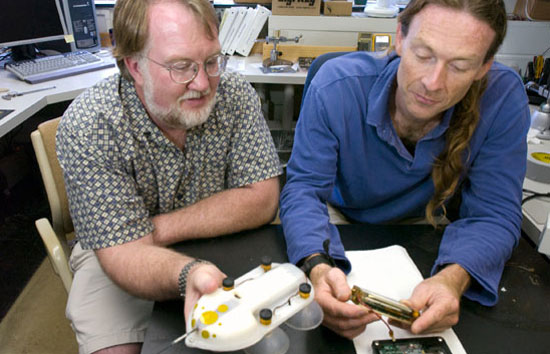 Engineer Mark Johnson (right) and biologist Peter Tyack work together to learn about whale behavior, using Johnson's D-tag to record whale movements, depth, and sounds on dives.