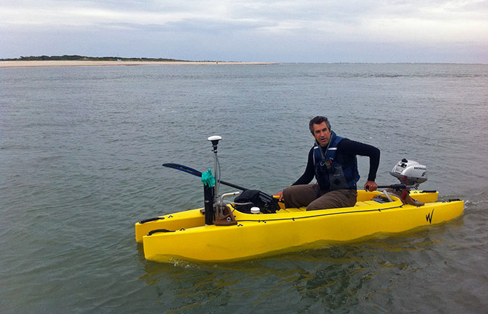 Peter Traykovski, a scientist at Woods Hole Oceanographic Institution, outfitted a catamaran kayak with scientific equipment to survey the ever-shifting sands of the New River Inlet in North Carolina.
