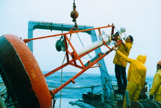 Jerry Dean fixing atmospheric instruments on buoy