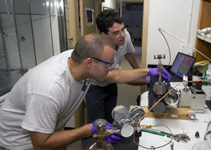 Sean Sylva and Jeff Seewald in the lab, working with Deepwater Horizon samples