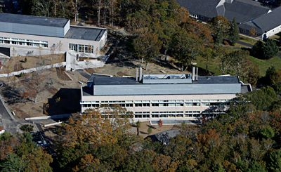 The capital campaign provided significant funds toward the construction of two new laboratories on the Quissett Campus: the Stanley W. Watson Laboratory (foreground) and the Marine Research Facility (left). (Photo by Bird's Eye View).