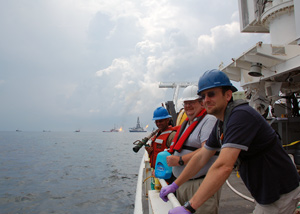 Ben Van Mooy and others on ship near the burning Deepwater Horizon oil rig