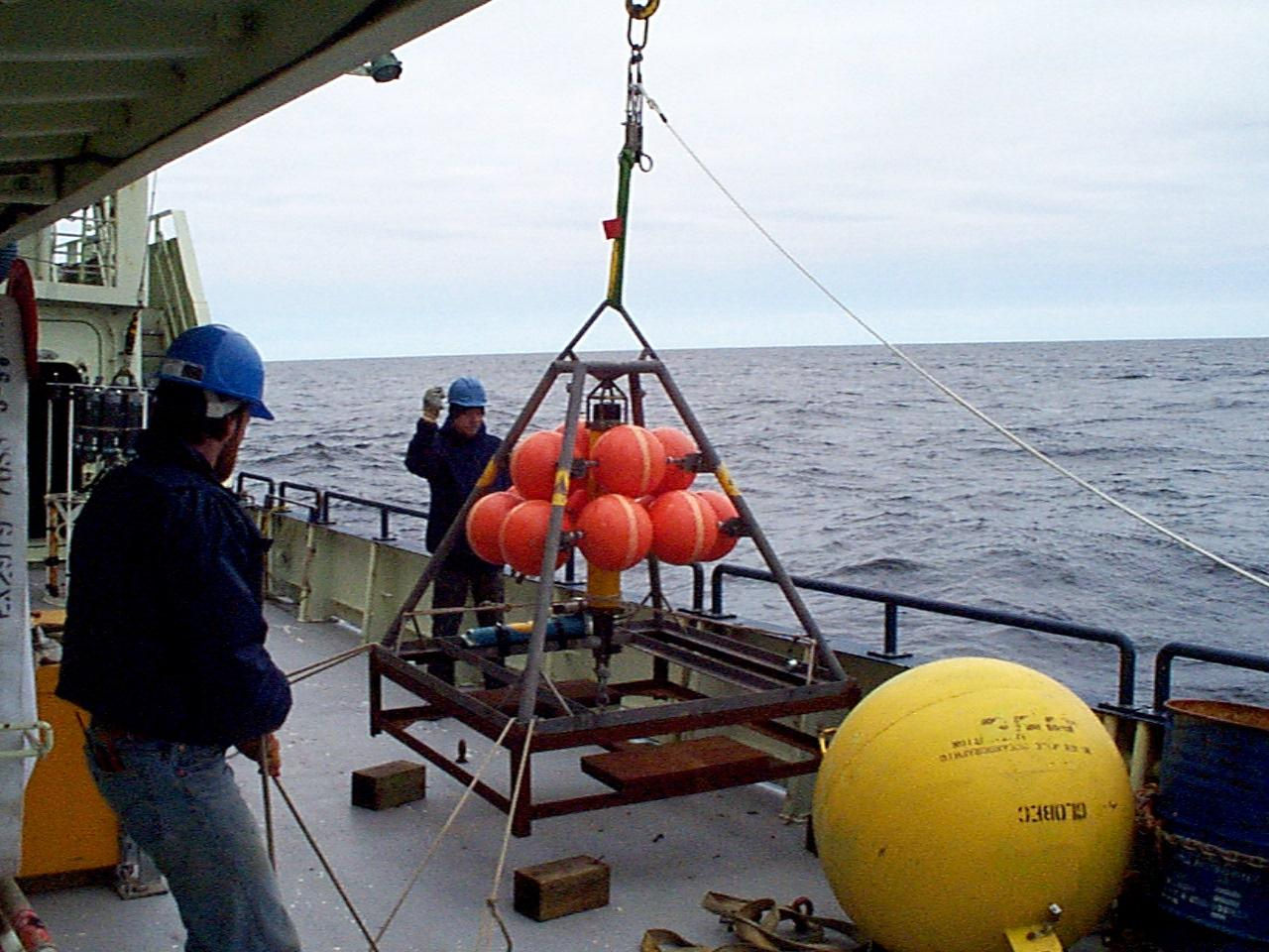 Jeff Lord and Jeff Stolp deploying a bottom pressure instrument on the Southern Flank of Georges Bank on OC321 in April 1998.