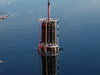 A conductivity/temperature/depth (CTD) rosette being lowered into the current.