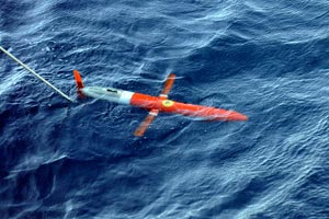 The Spray glider, developed by scientists at WHOI and Scripps, is a 6-foot, 110-pound, torpedo-shaped underwater vehicle that can remain at sea for months. It receives commands from scientists on shore who can direct its movements.