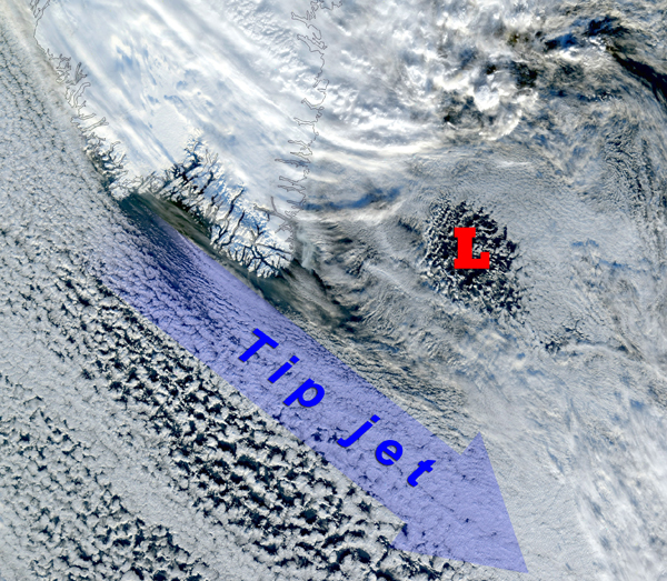 A storm (whose center is denoted by the red letter L) passes by Cape Farewell, initiating an occurrence of the Greenland tip jet, as indicated by the cloud streaks. This true color image was taken by a NOAA satellite on January 24, 2001.