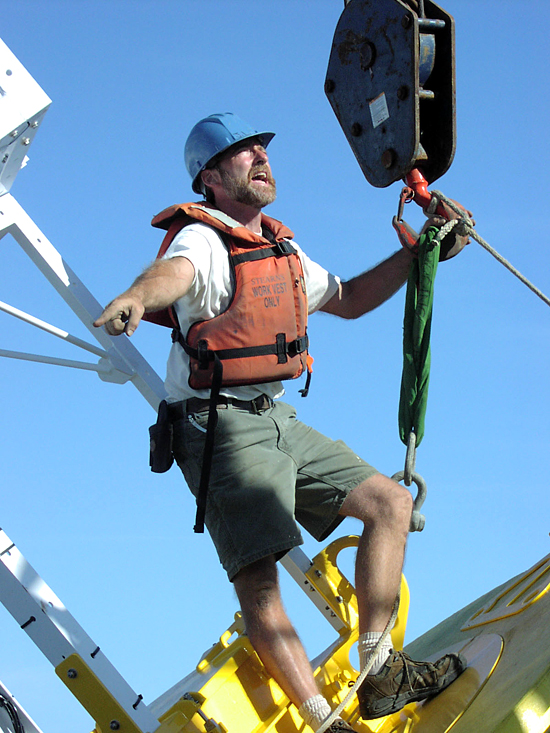 Jeff Lord directing the deployment of the WHOTS II buoy.