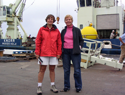 Amy Bower and Kate Fraser stand in front of R/V <em>Knorr</em> before departing on the cruise.