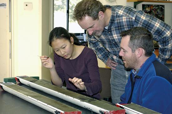Mea Cook examines a sediment core