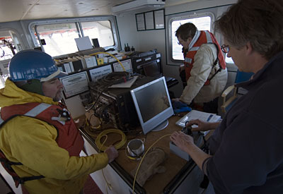 WHOI Engineer Tito Collasius drives the controls on a remotely operated vehicle, panning around with the camera looking for the missing mooring