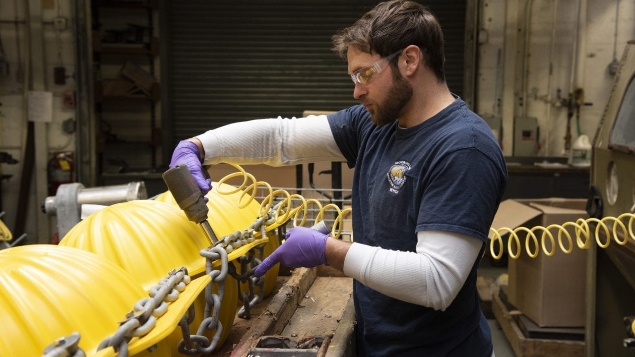 Ryan Laffey prepares glass ball hardhat flotation in the Mooring Lab