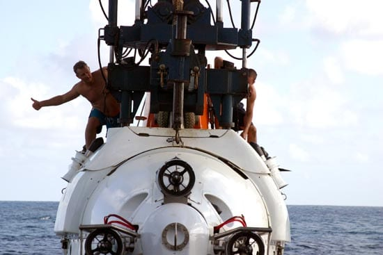 Support swimmers Carl Wood and Anthony Berry signal crew members aboard R/V Atlantis during an Alvin launch (Amy Nevala)