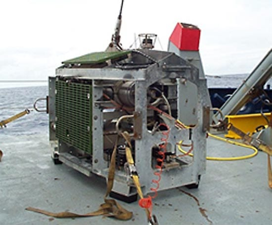 Medea, Jason's partner vehicle. Medea hangs from the research ship, attached by a steel cable (top) with the fiberoptic data tether encased inside. As the ship rolls in surface waves, the cable pulls on Medea but leaves Jason free to explore. (photo by Woods Hole Oceanographic Institution)