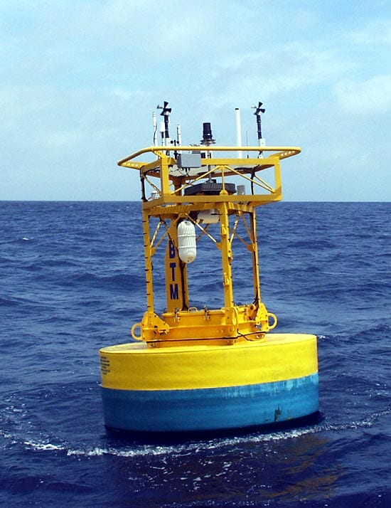 Aluminum buoys are prone to leaks after long periods at sea. Most newer buoys, like this one off Bermuda, are made of solid Surlyn foam that is much more durable and buoyant. The tower top has been further enlarged from earlier designs, and the square tower provides more headroom for engineers reaching into the buoy well. (Photo courtesy Bob Weller, WHOI)