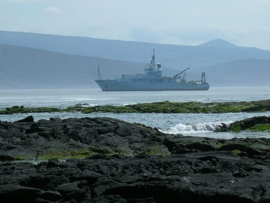 The R/V Thompson sails through the Galapagos Islands, January 2006. Below the ship, pulses of acoustic energy map the seafloor. (Jennifer Glass, UW, WHOI)