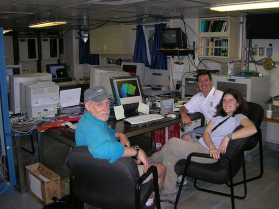 From left to right: Dr. Mark Holmes (Univ. Washington), Jennifer Glass (Univ. Washington) and Giorgio de la Torre (INOCAR, Ecuador) monitor incoming EM300 data on the R/V Thompson in the Galapagos Archipelago, January 2006. (Seelye Martin, UW)