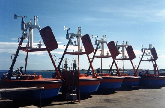 Early tower designs used a tripod shape, like on these FASINEX buoys from the early 1990s. They left little room for instruments and made it hard to get into the buoy well, where the batteries and data processors are stored. (photo courtesy Robert Weller, WHOI)