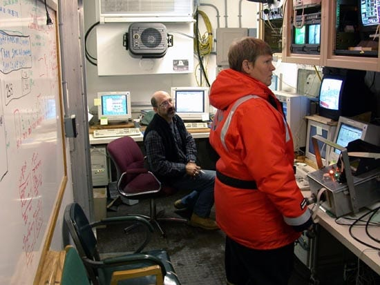 Inside the shipboard control room, or van, WHOI researchers Philip Alatalo and Dicky Allison monitor instrument readouts, watch the feed from the video plankton recorder, and plan where to position BIOMAPER. (photo by Gareth Lawson, WHOI)