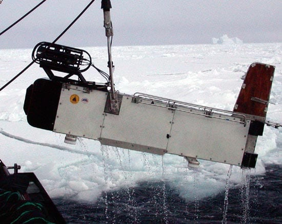 The BIOMAPER comes aboard during research in the Antarctic in 2002. The black apparatus above the nose is a video plankton recorder. Sonar units mounted in the body measure particle size up and down the water column. (photo by Gareth Lawson, WHOI)